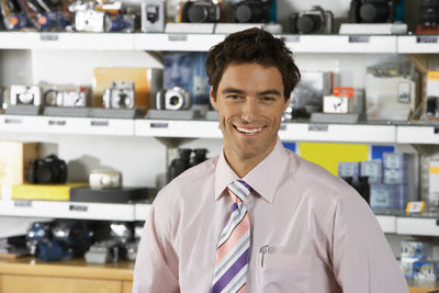 Salesman in Camera Store